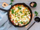 Shakshuka mit Tomaten und Zucchini Rezept